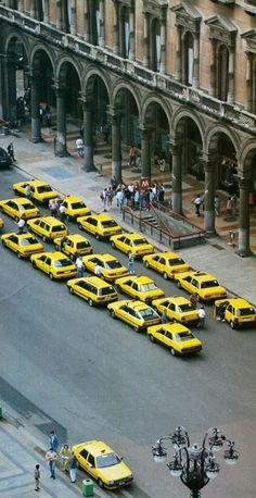 Yellow taxis Piazza del Duomo, Milan, Italy vintage pictures