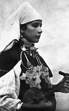 Tiznit , Anti Atlas, Morocco Amazigh Musician at the beginning of the XXth century in the South of Morocco, wearing two Berber fibulas