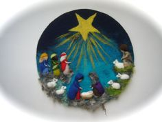 This picture with Mary,Joseph and Baby Jesus and the 3 Kings,shepherd and sheep. Needle Felted and wet felted. The child Jesus can be taken out of the