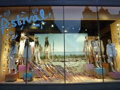 A theme for summer window display that includes white clothes and a festival background. this store for interior design Shop Interior Design, Exterior Design, Visual Merchandising, Logo Boutique, Festival Background, Shop Window Displays, Display Window, Les Themes, Shop House Plans
