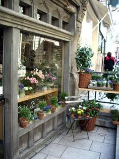 flower shops in paris | Angers has one, also. The small tins with rose nosegays were around ...
