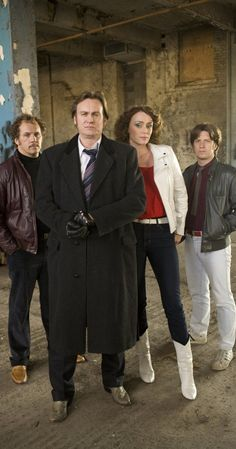 """Ashes to Ashes: DCI Gene Hunt flanked by his faithful sidekicks, Ray Carling and Chris Skelton, and drawn by the action and intrigue of the London Met. Gene's turned his attentions to taking on the """"southern nancy"""" criminal scum. However, Gene did not expect to be thrown together with a sexy, intelligent DI Alex Drake."""