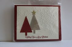 Under the Tree DSP, Northern Flurry embossing folder, Tree punch, star punch and cherry cobbler cardstock.  All Stampin' Up! products