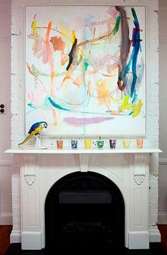 parrot figurine & art over Anna Spiro's mantel #art #bird #HGTV