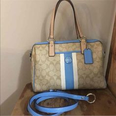 "% Authentic Coach Purse Very nice coach purse in GREAT condition I would say EXCELLENT! Does have a few spots inside bag not bad at all with a pen mark and on edge of inside bag by the zipper part is little dirty on both sides all way across not sure why it's dirty like that! The zipper pull as shown in pic the underline fabric is sliding out but still in great condition the strap is in EXCELLENT condition it has never been used! Outside bag is very clean! 12"" (L) x 8 1/4"" (H) x 5 1/2"" (W)…"