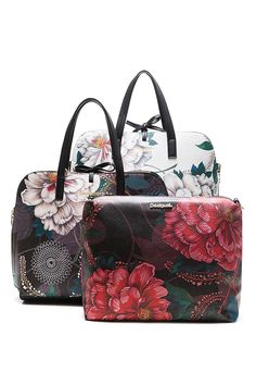 Desigual reversible bag with a floral print and removable strap.  There is nothing easy than having one bag matching all your outfits. Choose the bright color for warmer days or the dark color for colder day. Have a look at Desigual accessories!
