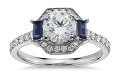 Round brilliant Halo engagement ring with sidestones. Click to find out everything you really need to know about Round Brilliant engagement rings!