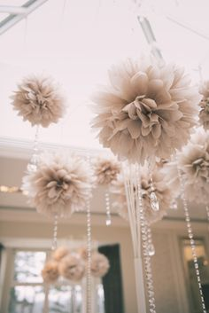 Champagne Pom Poms with Crystal Droplets & Crystal Garlands hanging from our amazing Multi Arm Tablestand centrepieces at Rockliffe Hall www.weddingandevents.co.uk