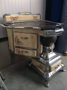 Victorian House Like This Page · 15 hrs · An Unusual Art Nouveau Cast Nickel & Porcelain Stove, from France (Circa Unusual Furniture, Victorian Furniture, Vintage Furniture, Cool Furniture, Cuisinières Vintage, Vintage Decor, Vintage Room, Antique Wood Stove, How To Antique Wood