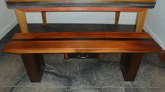 bench with reclaimed Ibeam legs, reclaimed wood top with metal strip down the center