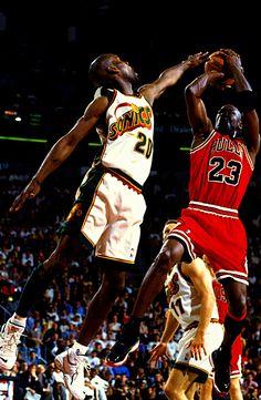 Michael Jordan shoots over Gary Payton