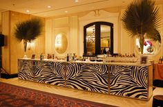 Tall palms topped the zebra-print bar for the jungle-themed cocktail reception.