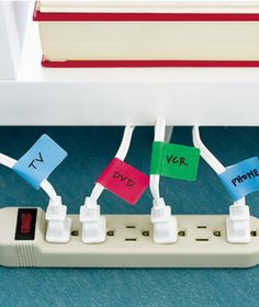 Attach adhesive file-folder labels with the names of the cords' owners (for example, phone, computer, fax, and lamp; or TV, DVD, VCR, and phone) near the plugs. This way, you can quickly ID which cord belongs to which machine—and you won't unplug the wrong one.