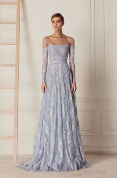 Featured Dress: Hamda Al Fahim; Long-sleeve off-the-shoulder blue wedding dress idea.