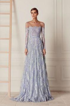 Featured Dress: Hamda Al Fahim; Long-sleeve off-the-shoulder blue wedding dress idea.