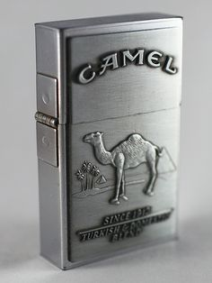 Promo replica 1932 Camel Zippo given away to people who smoke ungodly amounts of Camel cigarettes. Custom Lighters, Cool Lighters, Cigar Lighters, Cool Zippos, Cigar Accessories, Pipes And Cigars, Light My Fire, Zippo Lighter, Cigarette Case