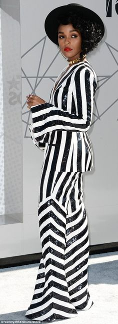 Stand-out star: There was no missing Janelle Monae in a sequined suit with stripes going i...