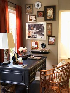 I have always loved this space. I saw it in the mag a while back. i like the colors: dark walls, rust red curtains, blk desk. and the mix of things on the walls. i hope someday i'll have the vision to do something like this.
