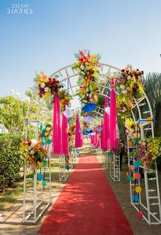 floral entrance, floral decor, pink tassles