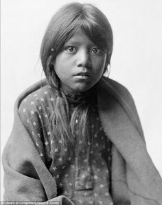 Innocence: A Taos girl, ca. 1905 is pictured looking straight into the camera, wrapped in a blanket