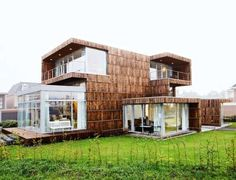 2012Architects Built a House from Old Billboards and Broken Umbrellas trendhunter.com