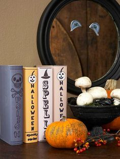 Add Halloween spirit to your living room with fall mantel decor, including homemade decorations and festive pumpkins. These cute and spooky crafts will bring style and scares to your Halloween mantel. Homemade Halloween Decorations, Halloween Books, Halloween Crafts For Kids, Halloween Party Decor, Spirit Halloween, Holidays Halloween, Halloween Diy, Spooky Decor, Easy Decorations