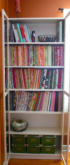 I love this fabric storage idea.  It really shows off the fabrics and makes them easy to see.  Now to find some space on my bookshelves...