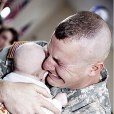A solider meeting his child for the first time. Sacrifice.