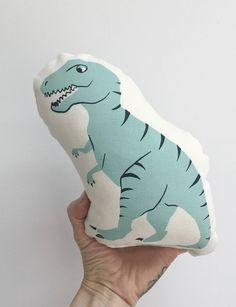 T-rex print soft toy. Made from organic cotton/hemp and hand printed with non toxic inks, this Dinosaur stands approximately 9 high. Available in green, aqua or bright pink. Please specify the colour in the comments. Contact us for local Toronto pick up or for overseas shipping quotes. All our products are hand printed by us, the uniqueness of each piece is the beauty of hand printed product.
