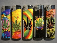 Very appropriately decorated lighters. Marijuana leaves