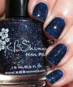 The PolishAholic: KBShimmer: Carpe Denim is a dark blue jelly base loaded with multiple sizes of silver holographic glitter. & Review