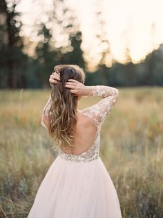 Illusion sleeve backless wedding dress: http://www.stylemepretty.com/2015/11/27/autumn-bridal-session-in-yosemite-national-park/   Photography: Cassidy Carson - http://www.cassidycarsonphotography.com/