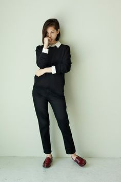 White collared shirt, black crew neck sweater, black slim trousers, brown Loafers.