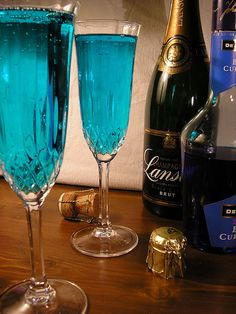 Blue Champagne | Dead easy, this, and colourful if not tasty. A half measure of Blue Curacoa swirled around the inside of a champagne glass to coat it and then topped up with... guess what?
