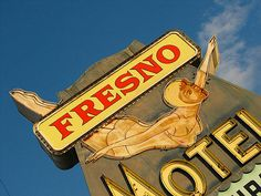 Fresno Motel - Fresno, California  Detail of the wonderful diving girl on the Fresno Motel sign. Located along a stretch of several vintage neon signs lining Highway 99.
