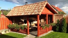 Compact outdoor kitchen with pizza oven and traditional stove ...