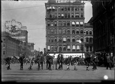 "cincylibrary: ""Cincinnati, Ohio, circa 1915. Race on roller skates at Government Square, East 5th Street, between Walnut and Main. """