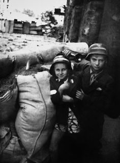 Inhabitants of the city of Warsaw during 1944 Warsaw Uprising, the major action of Polish resistance against the German occupation of the city during World War Images via Dom Spotkań z Historią. Poland Ww2, Invasion Of Poland, Germany Ww2, Warsaw Ghetto, Jewish Ghetto, Warsaw Uprising, History Images, Red Army, Black White