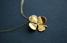 Real four leaf clover necklace in 24k by tyrahandmadejewelry