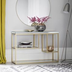 Plush Champagne Console Table  Creat a focal point with this stylish yet practical designer console table, featuring a bevelled mirror top and tempered mirrored shelves set into a modern, soft champagne coloured metal frame.
