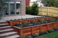 Beautifying Your Landscape Using Wooden Retaining Walls: Wooden Retaining Walls Ideas...also like the gravel filled stairs