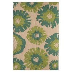 Anchor your living room seating group or define space in the den with this hand-tufted rug, showcasing a floral motif for garden-chic style....