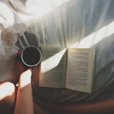 A book and coffee in bed. Throw in a couple of sleeping kids and an open window with blowing curtains. Dreamy!