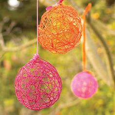 Mix equal parts of water and glue. Dip yarn in mixture and wrap around a balloon. Pop balloon when dry. Totally cool!!