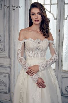 Calla Blanche wedding dress/gown- Arianna, ivory a-line style wedding dress with silk organza, off the shoulder, strapless, and long sleeves. For the Bride Boutique, Ft. Myers, FL