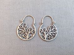 Handmade Sterling Silver Balinese style Earrings by Dream Mullick. Earrings measure 1 inch long and have a simple hook closure.