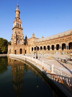 The Plaza de España is a building in Maria Luisa Park, in Seville, Spain built in 1928 for the Ibero-American Exposition of 1929. It is a landmark example of the Moorish Revival style in Spanish architecture.   Barcelona Airport Private Arrival Transfer Excursions in Barcelona Vacations in Barcelona Sightseeing tours, airport transfers, taxi, interpreter and your personal guide in Bar