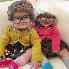 Babies dressed up as old ladies