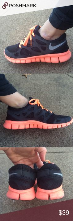 Nikes Excellent used condition women's Nike free. Black and neon coral. Women's size 9 Nike Shoes Athletic Shoes