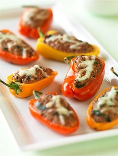Tiny peppers are packed with Ground Beef, spinach and couscous for a colorful appetizer that's easy on the waistline at only 35 calories each.